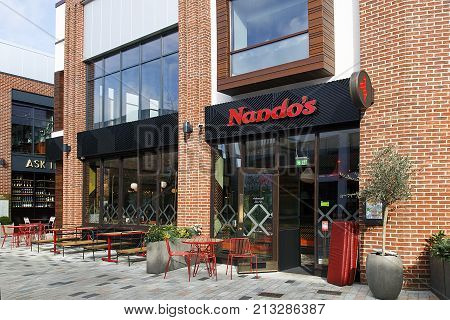 Stratford upon Avon, UK: October 14, 2017: Nando's is an international casual dining restaurant chain originating from South Africa, with a Mozambican/Portuguese theme, founded in 1987.