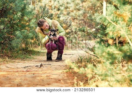 Baby Girl Outdoors With A Small Dog.smiling Teenage Girl Relaxing With Dog.