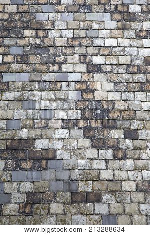 Slate tiles as a natural background texture in a vertical format
