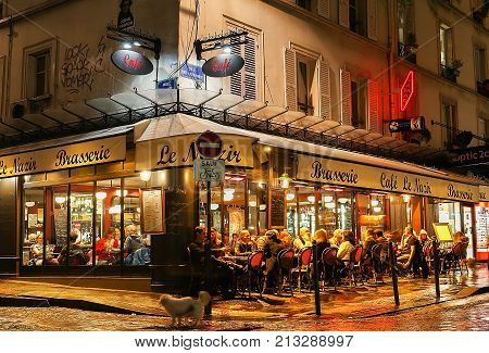 PARIS , France- November 11, 2017: View of typical paris cafe in Paris. Montmartre area is among most popular destinations in Paris, Nazir is a typical cafe.