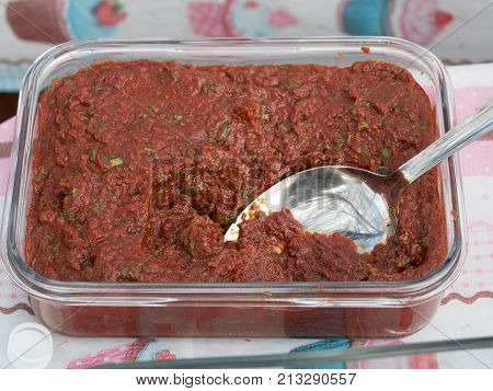 Homemade fresh salsa of tomato and pepper.