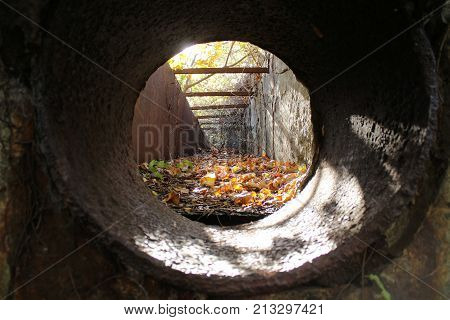 Large cast iron pipe drain of an old unused factory.