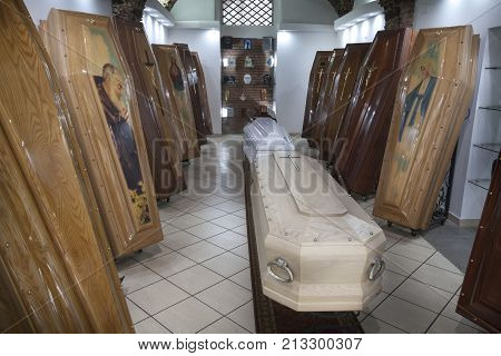 CATANIA, ITALY. April 03, 2015: Coffin shop. Display of coffins. A shop in the historic center of Catania, Sicily in Italy with several coffins on display.