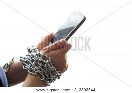 Hands chained by a chain holding a mobile phone isolated on a white background