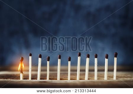 Row Of Matches, One Match Burns And Fades