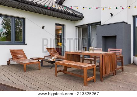 Patio With Wooden Furniture Set