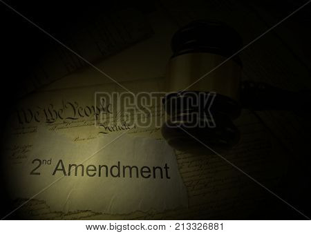 Second Amendment newspaper headline and gavel on the US Constitution