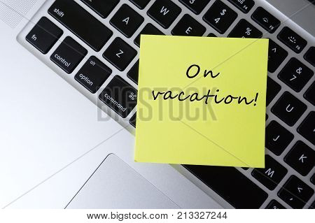 On Vacation Word Written On Sticky Notes On Top Of Laptop Keyboard