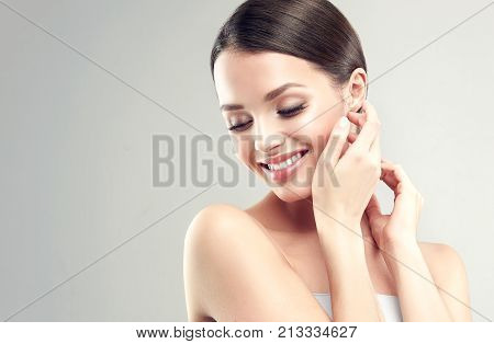 Beautiful Young Woman with Clean Fresh Skin . Facial  treatment   . Cosmetology , beauty  and spa .  Skin care . Beauty skin famale  face