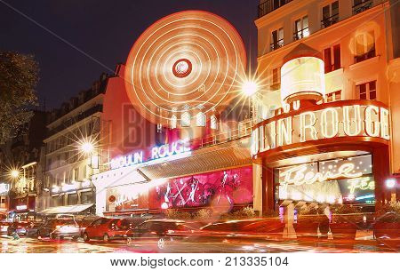 PARIS - November 11, 2017 : The Moulin Rouge by night, on November 11, 2017 in Paris, France. Moulin Rouge is a famous cabaret built in 1889, locating in the Paris red-light district of Pigalle
