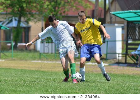 KAPOSVAR, HUNGARY - JUNE 11: Konrad Kiss (in white) in action at the Hungarian National Championship under 17 game between Kaposvari Rakoczi FC and Bajai LSE on June 11, 2011 in Kaposvar, Hungary.