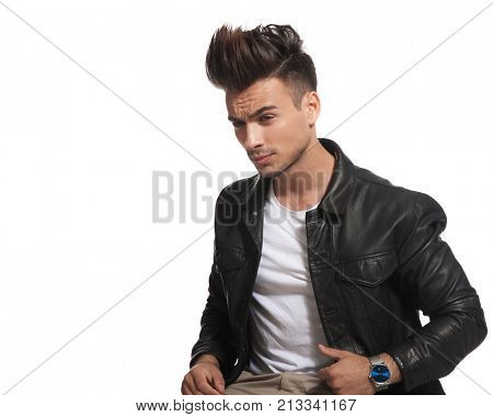 side view picture of a seated attractive man with cool hair style on white background