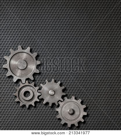 gears and cogs on steam punk metal background 3d illustration