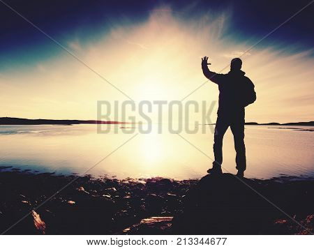 Slim Sportsman On Nord Sea Coast. Hiker Open Arms To The Sunrise Stand At Seaside  Boulder
