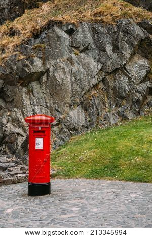 Red mail box (royal mail pillbox) with copy space Edinburgh Castle Scotland