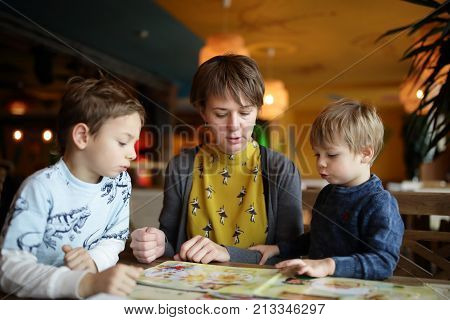 Family choosing dishes at table in the restaurant