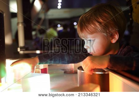 Kid Studying The Refraction Of Light