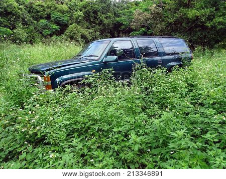 Mandalay, Queensland, Australia-March 21, 2017:  A discarded Chevrolet SUV deteriorating in a paddock in Tropical Australia