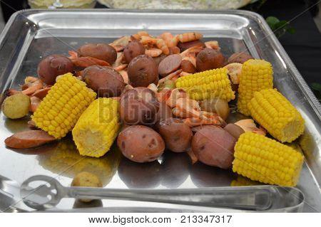 lowcountry boil dinner on sterling silver platter