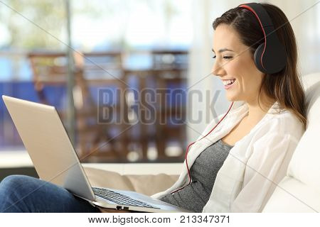 Female Watching Media On Line In A Laptop