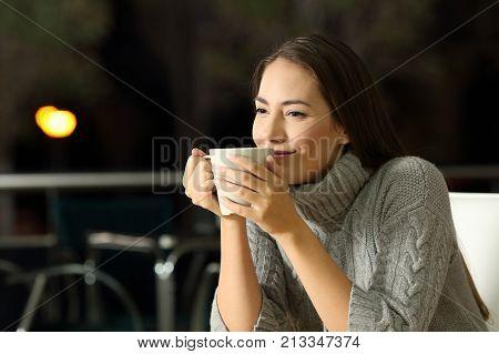 Pensive Woman Enjoying Cofee In A Bar At Night