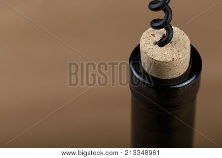 a bottle of wine is opened with a corkscrew a corkscrew is screwed into a bottle stopper