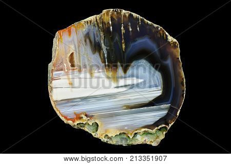 A cross section of the agate stone. Stalactite-horizontal agate. Multicolored silica bands colored with metal oxides are visible. Origin: Rudno near Krakow Poland.