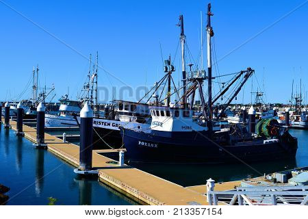 October 12, 2017 in Crescent City, CA:  Commercial Fishing Vessels parked at the large spacious docks in the Crescent City, CA Harbor Marina where locals and tourists can purchase freshly caught fish from the vessels themselves during weekends