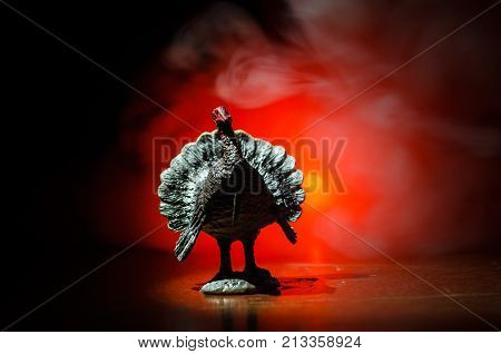 Statue Of Turkey Tom Strutting His Stuff With Red Wattles And Blue/white Head On A Smoke Toned Dark