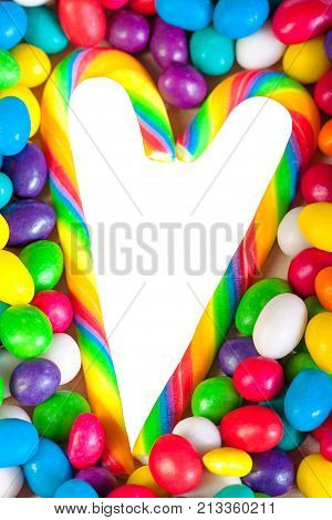 frame from heart from colorful sweets of sugar candies. background from on candies. colored sweets close up