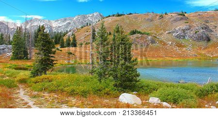 Bellamy Lake below the rugged mountains of the Snowy Range in Medicine Bow National Forest of Wyoming