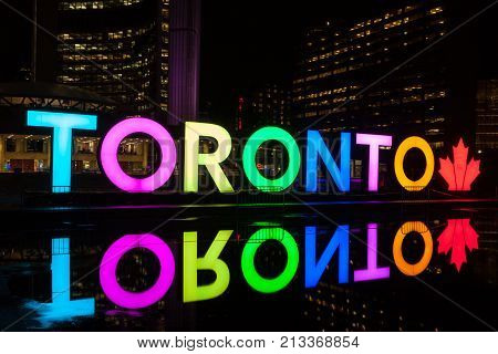 Toronto Canada - Oct 12 2017: Colorful illuminated Toronto sign at the Nathan Phillips Square in Toronto Canada