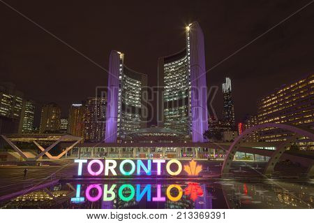 Toronto Canada - Oct 10 2017: Colorful illuminated Toronto sign at the Nathan Phillips Square in Toronto Canada
