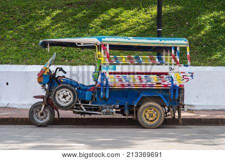 Luang Prabang, Laos - December 21, 2015: A regular auto rickshaw service in the world heritage site, Luang Prabang, Laos.