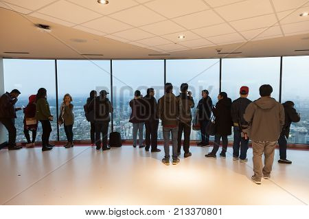 Toronto Canada - Oct 11 2017: People at the observation platform of the CN Tower in the city of Toronto. Province of Ontario Canada
