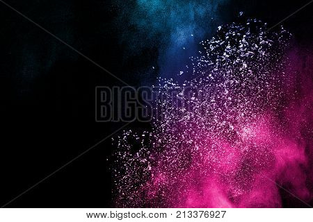 Multicolored powder splash cloud isolated on black background.abstract color powder splatter on black background,Freeze motion of color powder exploding.
