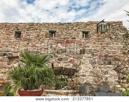 Citadel of the Old Town of Budva, Montenegro. Fragment of the wall with loopholes. Budva is one of the best preserved medieval Mediterranean cities.