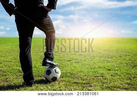businessman with a soccer ball on a pitch.Business sport concept