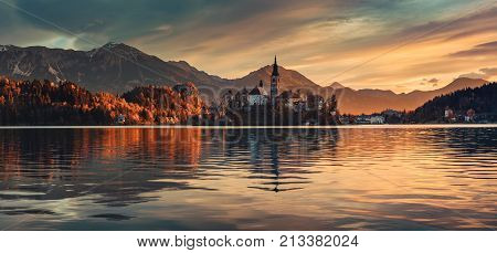 Lake Bled with St. Marys Church of the Assumption on the small island; Bled Slovenia Europe.