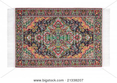 Carpet with varicolored pattern horizontally lies on white background