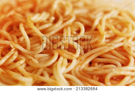 close up of spaghetti in sauce