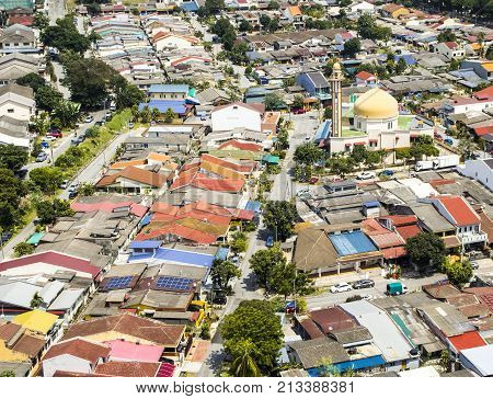 Aerial view of mosque surrounded by colourful neighbourhood in suburb of Kuala Lumpur