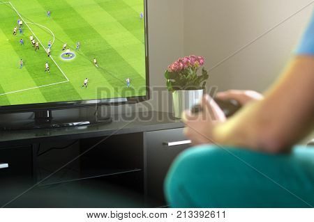 Man Playing Imaginary Soccer Or Football Console Game On Tv At Home.