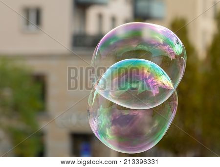 Soap Bubbles In Front Of An Old House And Trees