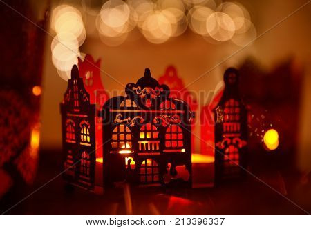 Home Decoration in Candle Light Christmas Abstract Lighting House Decor over De Focused Lighting Background