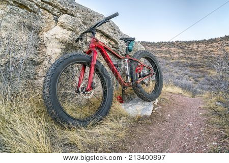 fat bike on a trail in Soapstone Prairiere Natural Area in northern Colorado, late fall scenery