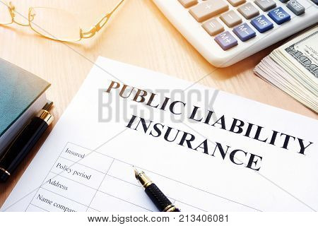 Public liability insurance policy on an office desk.