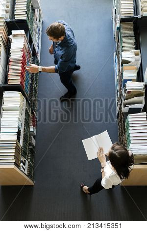 Students learning, reading in the library, view from above