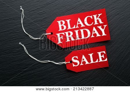 Black Friday Sale tags on dark background