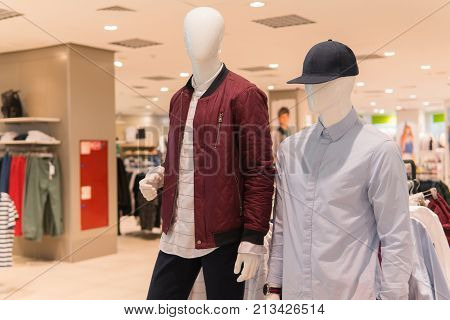 Male Mannequins In Jacket, Shirt And Baseball Cap